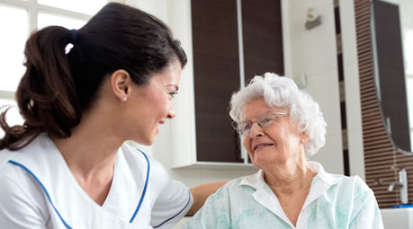 nurse providing medicare services to her patient